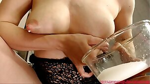 Mom talks dirty and milk her tits. A lot of milk!